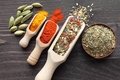 Blend of spices colorful on wooden spoons and copper bowl beautiful kitchen image Royalty Free Stock Photos