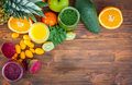 Blended green yellow and purple smoothie with ingredients selective focus Stock Photo