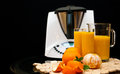 Blender or mixer with oranges still life composition a machine and fresh and orange juice Stock Photography