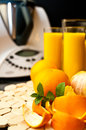 Blender or mixer with oranges still life composition a machine and fresh and orange juice Royalty Free Stock Images