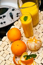 Blender or mixer with oranges still life composition a machine and fresh and orange juice Royalty Free Stock Photo
