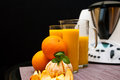 Blender or mixer with oranges still life composition a machine and fresh and orange juice Royalty Free Stock Image