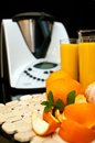 Blender or mixer with oranges still life composition a machine and fresh and orange juice Stock Image