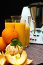 Blender or mixer with oranges still life composition a machine and fresh and orange juice Royalty Free Stock Photography