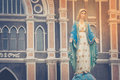 The Blessed Virgin Mary statue standing in front of The Roman Catholic Diocese that is public place. Royalty Free Stock Photo