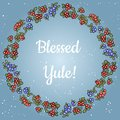 Blessed Yule lettering in a wreath of red and blue berries. Vector postcard