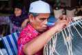 Blind man weaving basket a from rattan Royalty Free Stock Images