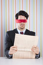 Blind reading a newspaper at the office Royalty Free Stock Photography