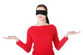 Blindfold woman presenting copy space Stock Images