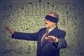 Blindfolded elderly senior business man going through social media data