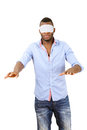 Blindfolded man groping around a vertical image on white background Royalty Free Stock Photo