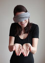 Blindfolded young woman showing palms Royalty Free Stock Photo