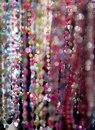Bling with glass pearl necklaces on a rack Royalty Free Stock Photography
