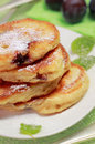 Blinis (from white flour, with plum) on plate Stock Image