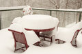 Blizzard snow covering outdoor furniture during a shot outdoors during the storm Stock Image
