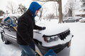 Blizzard west hempstead ny jan teenage boy clears snow from car on long island ny on jan after snow storm this powerful nor easter Royalty Free Stock Photo