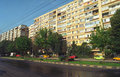 Block of flats and road in bucharest city film scan visible grain Royalty Free Stock Images