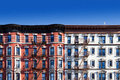 Block of old buildings in New York City with blue sky background Royalty Free Stock Photo