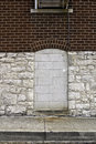 Blocked up a doorway or window in a block wall with cement blocks Stock Photos
