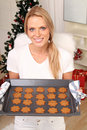 Blond angel with cookies Stock Images