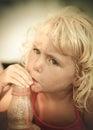 Blond baby girl on the beach