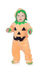 Blond baby in pumpkin suit isolated on a white background Stock Photos