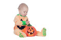 Blond baby in pumpkin suit isolated on a white background Royalty Free Stock Photo