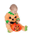 Blond baby in pumpkin suit isolated on a white background Stock Images
