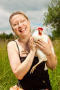 Blond beautiful woman hugs an white chicken cute Stock Images
