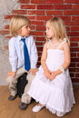 Blond boy and beautiful girl Royalty Free Stock Photos