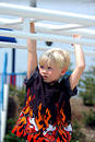 Blond Boy Child On Bars Royalty Free Stock Photo