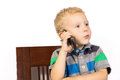 Blond boy emotionally and proudly talking on cell phone Stock Photos