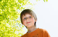 Blond boy enjoying sunny day in a park horizontal backlit portrait of Stock Photography