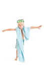 Blond boy wearing swimming shorts and swimming mask with a blue towel studio shot isolated on a white background Stock Photos