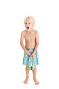 Blond boy wearing swimming shorts with swimming mask. The boy opened his mouth. Royalty Free Stock Photo
