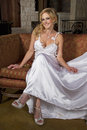 Blond bride wearing wedding gown young beautiful smiling a satin bridal Stock Image