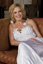 Blond bride wearing wedding gown young beautiful smiling a satin bridal Royalty Free Stock Photography