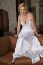 Blond bride wearing wedding gown young beautiful smiling a satin bridal Stock Photo