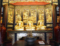 Blond budda statue in ancient hall Stock Photo