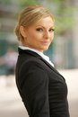 Blond business woman standing outdoors portrait of a in the city Stock Image