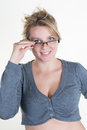 Blond business woman touching her glasses isolated Royalty Free Stock Photo