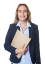 Blond businesswoman with blue eyes and blazer and file Royalty Free Stock Photo