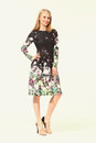 Blond Busyness Woman Fashion Model in summer print flower dress Royalty Free Stock Photo