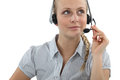 Blond call center agent wearing a head set Stock Photo