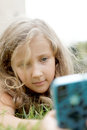 Blond child girl on nature Stock Images