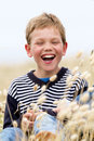 Blond child laughing in nature Royalty Free Stock Photo