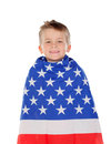 Blond child wrapped on American flag Royalty Free Stock Photo