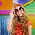 Blond children happy tourist girl smiling with sunglasses on a tropical house Stock Photo
