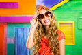 Blond children happy tourist girl  smiling with sunglasses Royalty Free Stock Photo