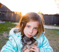 Blond children kid girl playing with puppy dog chihuahua hairy Royalty Free Stock Image